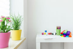 Crayons on a table. In child room stock photo