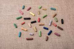 Crayons of various color on a canvas Royalty Free Stock Photo
