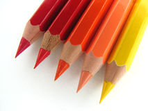 Crayons Warm. Colorful wooden crayons against white background Stock Photos