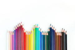 Crayons and watercolor pastels lined up isolated on white backgr Royalty Free Stock Photography