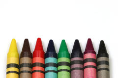 Crayons on white. Multicolored crayons wrapped in colors on a white background Stock Image