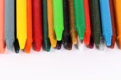 Crayons on white background. Colorful crayons over white background Royalty Free Stock Image