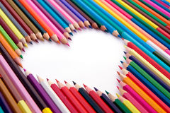 Crayons and the white heart. A lot of crayons and the white heart royalty free stock photo