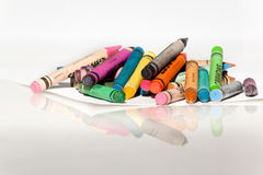 Crayons on white reflecting surface Stock Photography