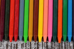 Crayons on wood background. Colorful crayons over wood background Royalty Free Stock Image