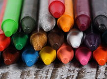 Crayons on wood background. Colorful crayons over wood background Stock Photos