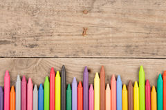 Crayons on the wooden desk Stock Photography