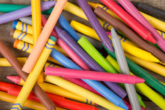 Crayons on the wooden desk Royalty Free Stock Photos