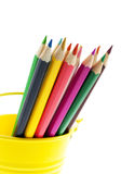 Crayons in yellow bucket Royalty Free Stock Photo