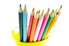 Crayons in yellow bucket Royalty Free Stock Photos