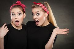 Crazy pin up retro girls making funny faces. Craze fun and positive madness. Women showing their funny faces feel carefree. Girls in retro pin up fashion style royalty free stock images