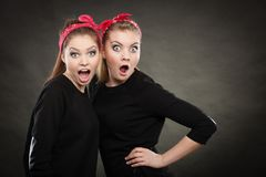 Crazy pin up retro girls making funny faces. Craze fun and positive madness. Women showing their funny faces feel carefree. Girls in retro pin up fashion style stock image