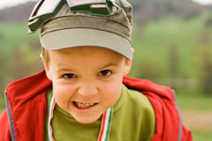 Crazed boy. Angry boy making faces - looking to the camera - shallow depth of field Stock Photo