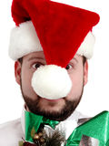Crazed Christmas Shopper w/Clipping Path. Man in Santa hat and arms full of gifts isolated on white with clipping path Royalty Free Stock Image