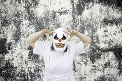Crazed Clown. Crazy clown mask halloween costume and fear Royalty Free Stock Image