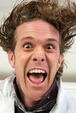 Crazy. Head shot of thirty something man making crazy facial expression Stock Image