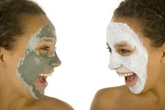 We are crazy. Happy young women with masks anti-aging. They're on white background Royalty Free Stock Photography
