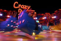 Crazy adolescence. Speedy attraction in amusement park, motion blur Stock Image