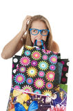 Crazy amusing confused  girl with shopping gift bags. Royalty Free Stock Photography