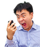 Crazy angry asian man yelling at. Isolation photo of a crazy angry asian man yelling at his cellphone Stock Images