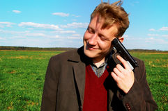 Crazy as loon. Strange man in a field with a gun Stock Photos