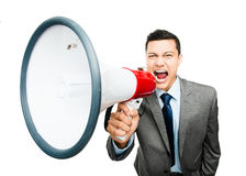 Crazy Asian businessman screaming in megaphone on white backgrou Royalty Free Stock Photography