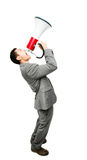 Crazy Asian businessman screaming in megaphone on white backgrou Royalty Free Stock Photo