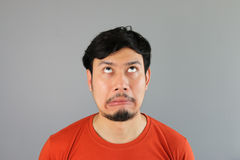 Crazy asian man. Crazy asian man is looking up stock image