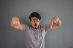 Crazy Asian man is pointing down. Stock Photography