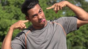 Crazy Athletic Hispanic Adult Male. A handsome adult hispanic man stock footage