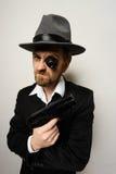 Crazy beard detective whit gun in hat Stock Photography