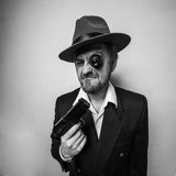 Crazy beard detective whit gun in hat Royalty Free Stock Photos