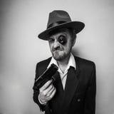 Crazy beard detective whit gun in hat Royalty Free Stock Photos