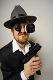 Crazy beard detective whit gun in hat Stock Images