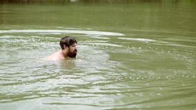 Crazy bearded man in river. Beard in water. Handsome hipster man having fun in fresh water. Crazy bearded man in river. Beard in water. Handsome hipster man stock video footage