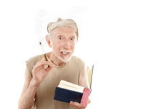 Crazy Beat Poet. Crazy Senior Beat Poet Reading from a Small Blue Book royalty free stock images