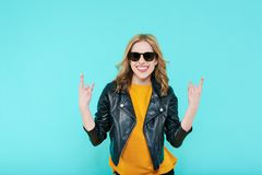 Crazy beautiful rock Girl in leather jacket and black sunglasses. Punk is not dead. Attractive cool young woman. Crazy beautiful rock Girl in leather jacket and Stock Image