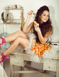 Crazy beauty brunette housewife on kitchen cooking Stock Photo