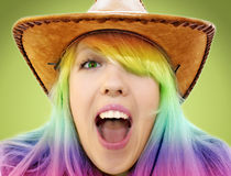 Crazy beauty cowgirl screaming. On green Royalty Free Stock Images