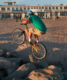 Crazy biker rock hopping. Rock hopping on bike. At a beach in Santa Cruz California one can expect to see anything Stock Image