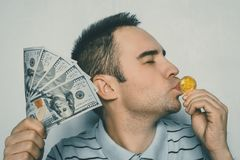 Crazy bitcoin lover with golden coin funny miner with btc. Bitcoin lover with golden coin funny miner with btc. Miner is happy to make money on the growth of Royalty Free Stock Photo