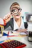Crazy bizarre businesswoman with big loupe. Royalty Free Stock Images