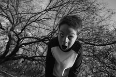 Crazy Boy. Boy in the forest screams in fear Royalty Free Stock Images