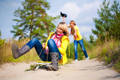 Crazy boy and girl are sledding at summer Royalty Free Stock Photography
