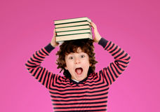 Crazy boy with many books on the head Stock Photo