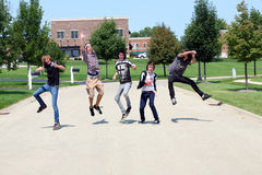 Crazy Boys. Teen boys leaping in a residential setting stock photo