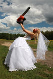 Crazy bride with red chainsaw Royalty Free Stock Image