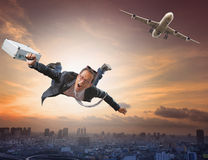 Crazy business man flying from passenger plane with glad and hap Royalty Free Stock Photos