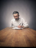 Crazy business man at work. Crazy business man working on a wooden office table, wide angle shot with space for text or image royalty free stock photo