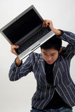 Crazy Business man with worn-out laptop Royalty Free Stock Photos